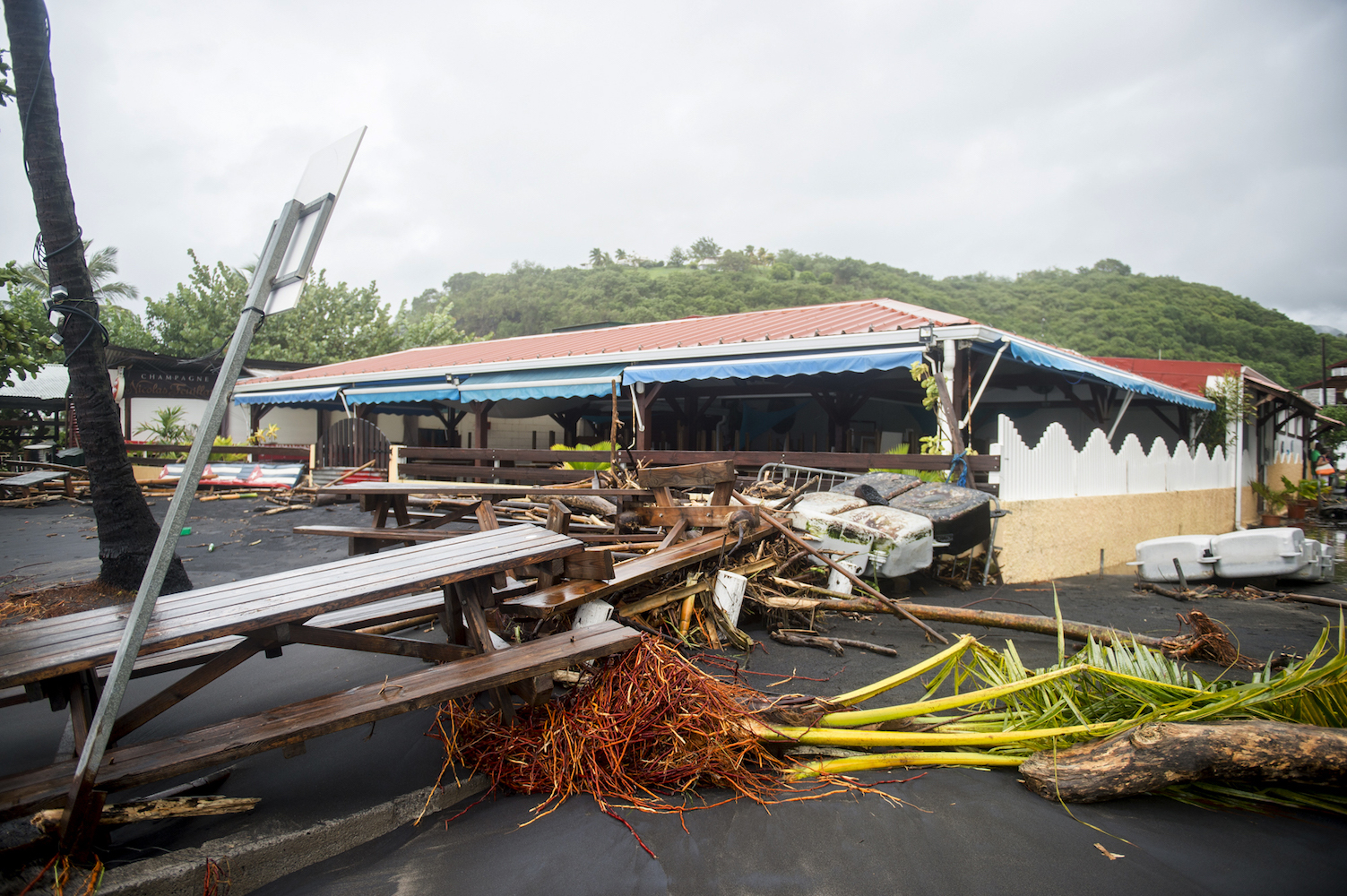 <div class='meta'><div class='origin-logo' data-origin='Creative Content'></div><span class='caption-text' data-credit='LIONEL CHAMOISEAU/AFP/Getty'>A picture shows damages at a restaurant in Le Carbet, on the French Caribbean island of Martinique, after it was hit by Hurricane Maria, on September 19, 2017.</span></div>