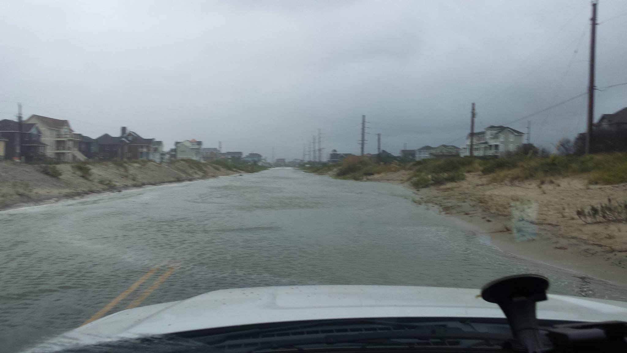 """<div class=""""meta image-caption""""><div class=""""origin-logo origin-image none""""><span>none</span></div><span class=""""caption-text"""">NC12 is temporarily closed just north of the Pea Island Visitors Center while we wait for the tide to subside. (Credit: NC DOT 12/Facebook)</span></div>"""