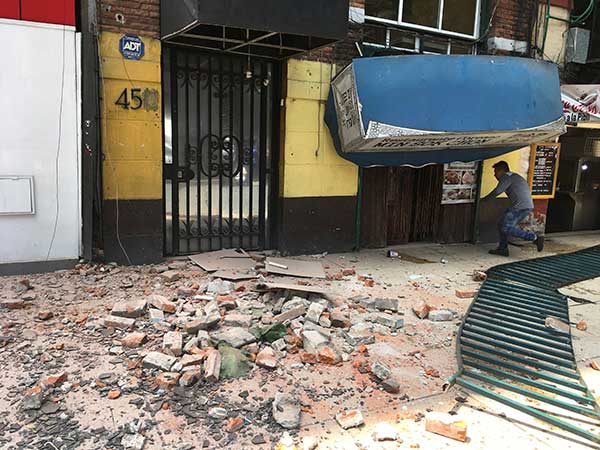 <div class='meta'><div class='origin-logo' data-origin='AP'></div><span class='caption-text' data-credit='AP Photo/Eduardo Verdugo'>A man enters a damaged building after an earthquake in Mexico City, Tuesday, Sept. 19, 2017.</span></div>