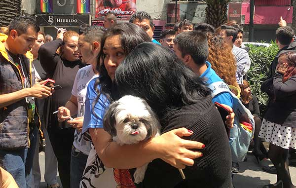 "<div class=""meta image-caption""><div class=""origin-logo origin-image ap""><span>AP</span></div><span class=""caption-text"">Women embrace in the street after an earthquake in Mexico City, Tuesday, Sept. 19, 2017. (AP Photo/Eduardo Verdugo)</span></div>"