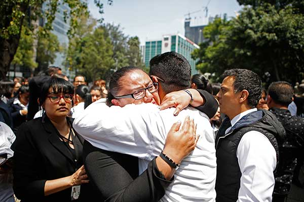"<div class=""meta image-caption""><div class=""origin-logo origin-image ap""><span>AP</span></div><span class=""caption-text"">A woman is comforted after an earthquake in Mexico City Tuesday Sept. 19, 2017. (AP Photo/Eduardo Verdugo)</span></div>"