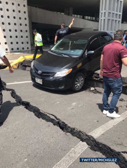 "<div class=""meta image-caption""><div class=""origin-logo origin-image none""><span>none</span></div><span class=""caption-text"">A cracked road is seen in the aftermath of a powerful earthquake to hit Mexico on Tuesday, Sept. 19, 2017. (Twitter/michglez)</span></div>"