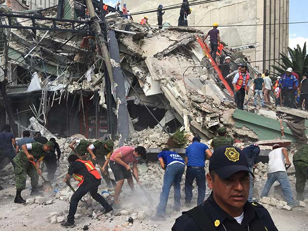 <div class='meta'><div class='origin-logo' data-origin='AP'></div><span class='caption-text' data-credit='AP Photo/Enric Marti'>People search for survivors in a collapsed building in the Roma neighborhood of Mexico City, Tuesday, Sept. 19, 2017.</span></div>
