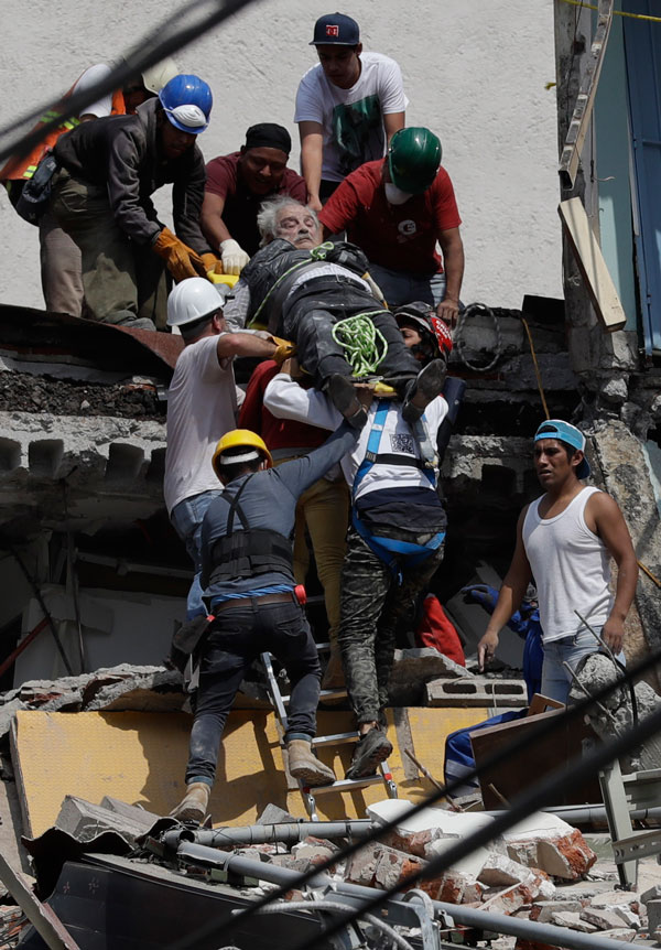 <div class='meta'><div class='origin-logo' data-origin='AP'></div><span class='caption-text' data-credit='AP Photo/Rebecca Blackwell'>An injured man is pulled out of a building that collapsed during an earthquake in the Roma Norte neighborhood of Mexico City, Tuesday, Sept. 19, 2017.</span></div>