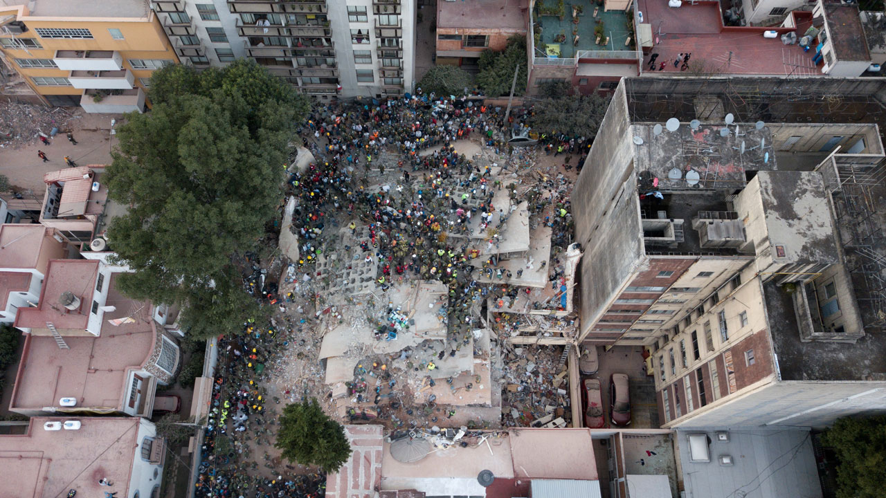 <div class='meta'><div class='origin-logo' data-origin='AP'></div><span class='caption-text' data-credit='AP Photo/Miguel Tovar'>Rescue workers and volunteers search for survivors on a collapsed building the Del Valle neighborhood in Mexico City, Tuesday Sept. 19, 2017.</span></div>