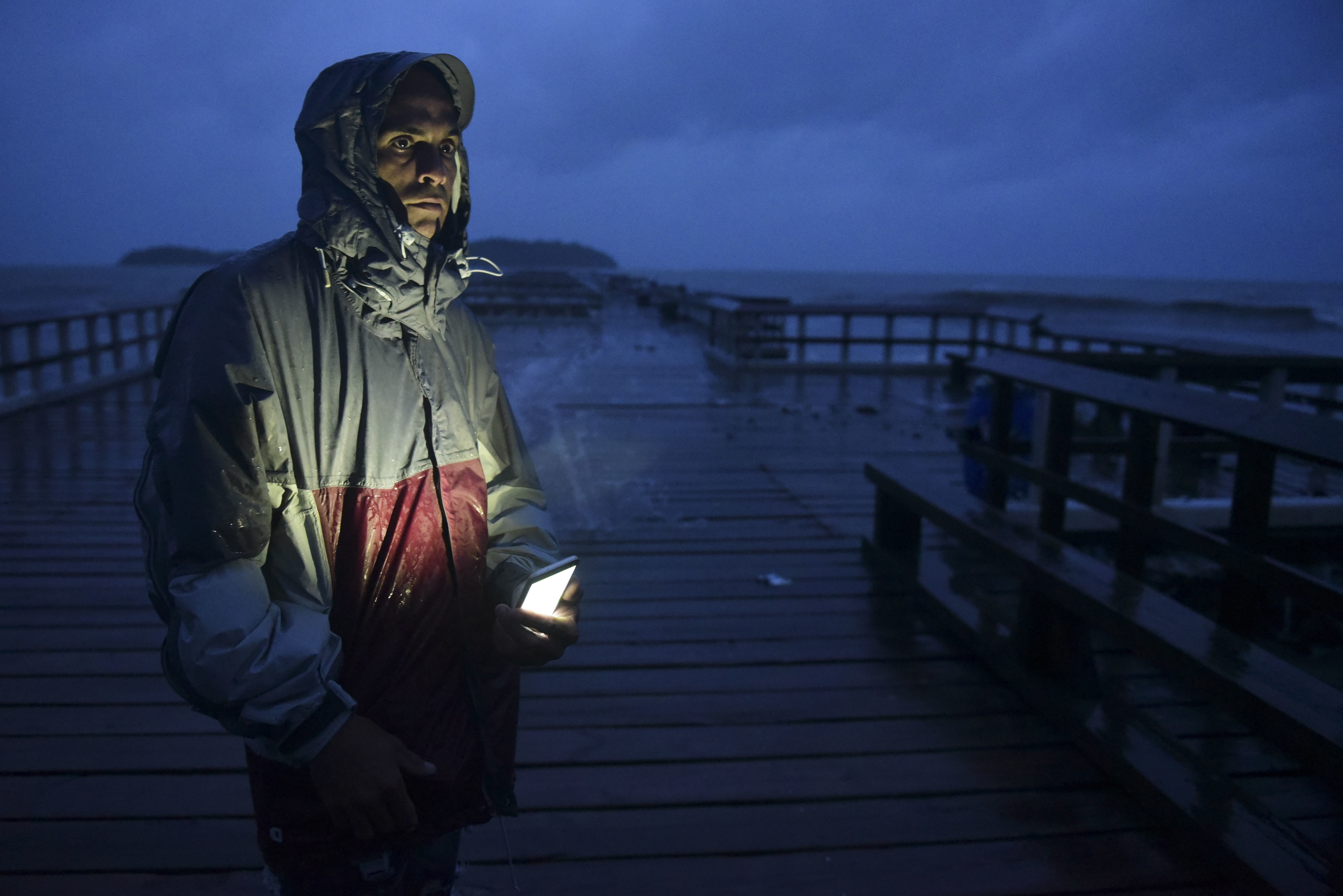 <div class='meta'><div class='origin-logo' data-origin='none'></div><span class='caption-text' data-credit='Carlos Giusti/AP Photo'>David Cruz Marrero watches the waves at Punta Santiago pier hours before the imminent impact of Maria on Tuesday, September 19, 2017.</span></div>