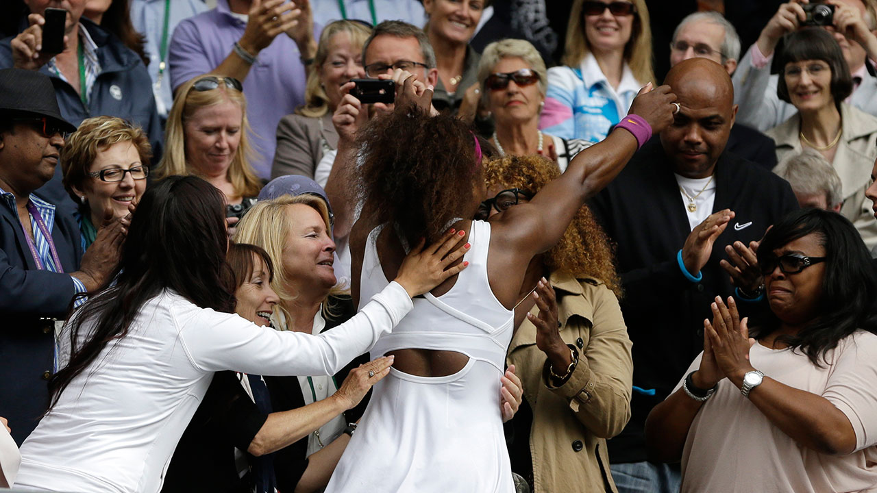 Serena Williams of the United States, center left, hugs her mother Oracene Price