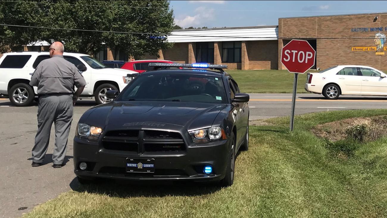 A deputy near Eastern Wayne High School Wednesday.