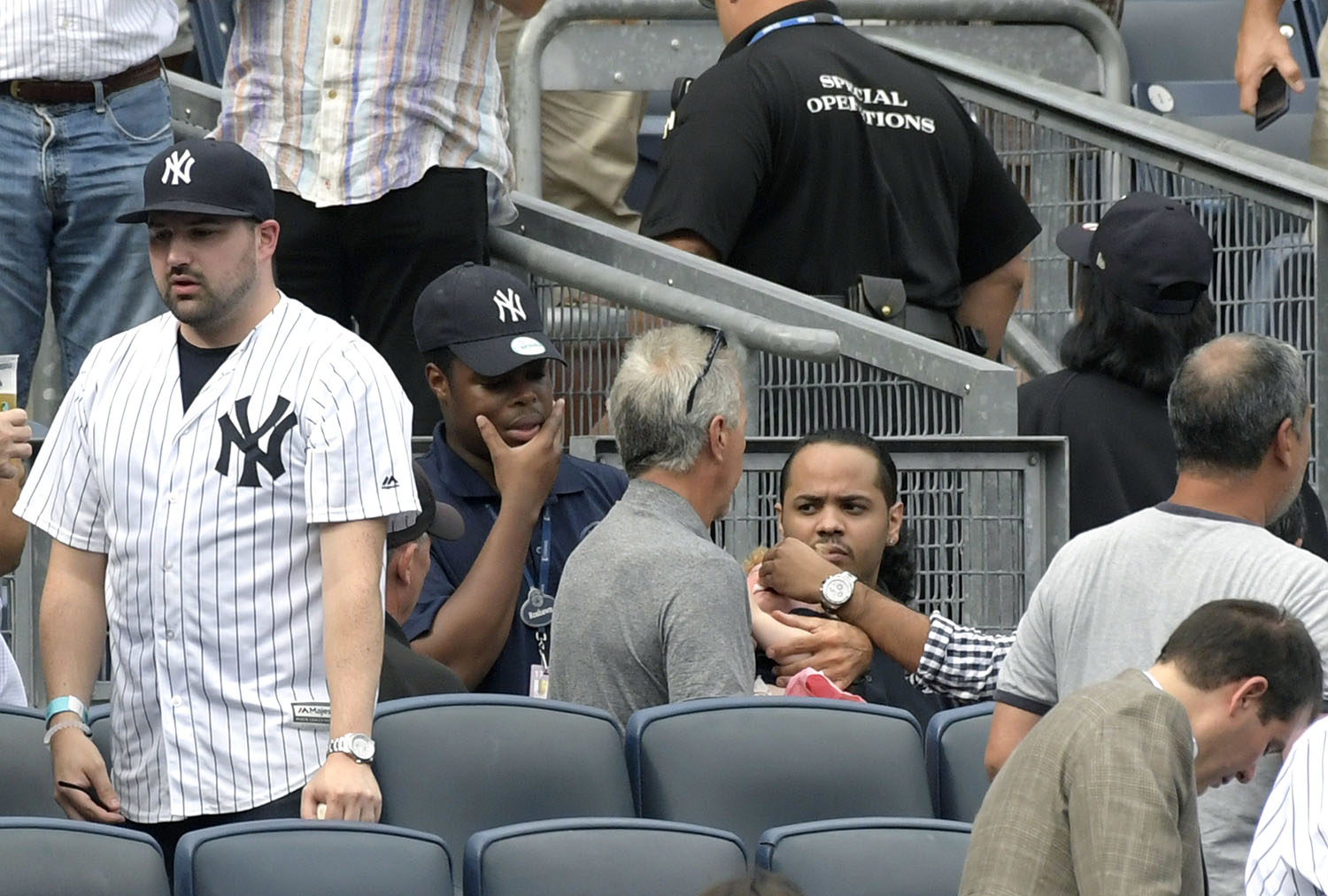 <div class='meta'><div class='origin-logo' data-origin='AP'></div><span class='caption-text' data-credit='AP Photo/Bill Kostroun'>Baseball fans react as a young girl is tended to before she is carried out of the seating area after being hit by a line drive in the fifth inning of a baseball game.</span></div>