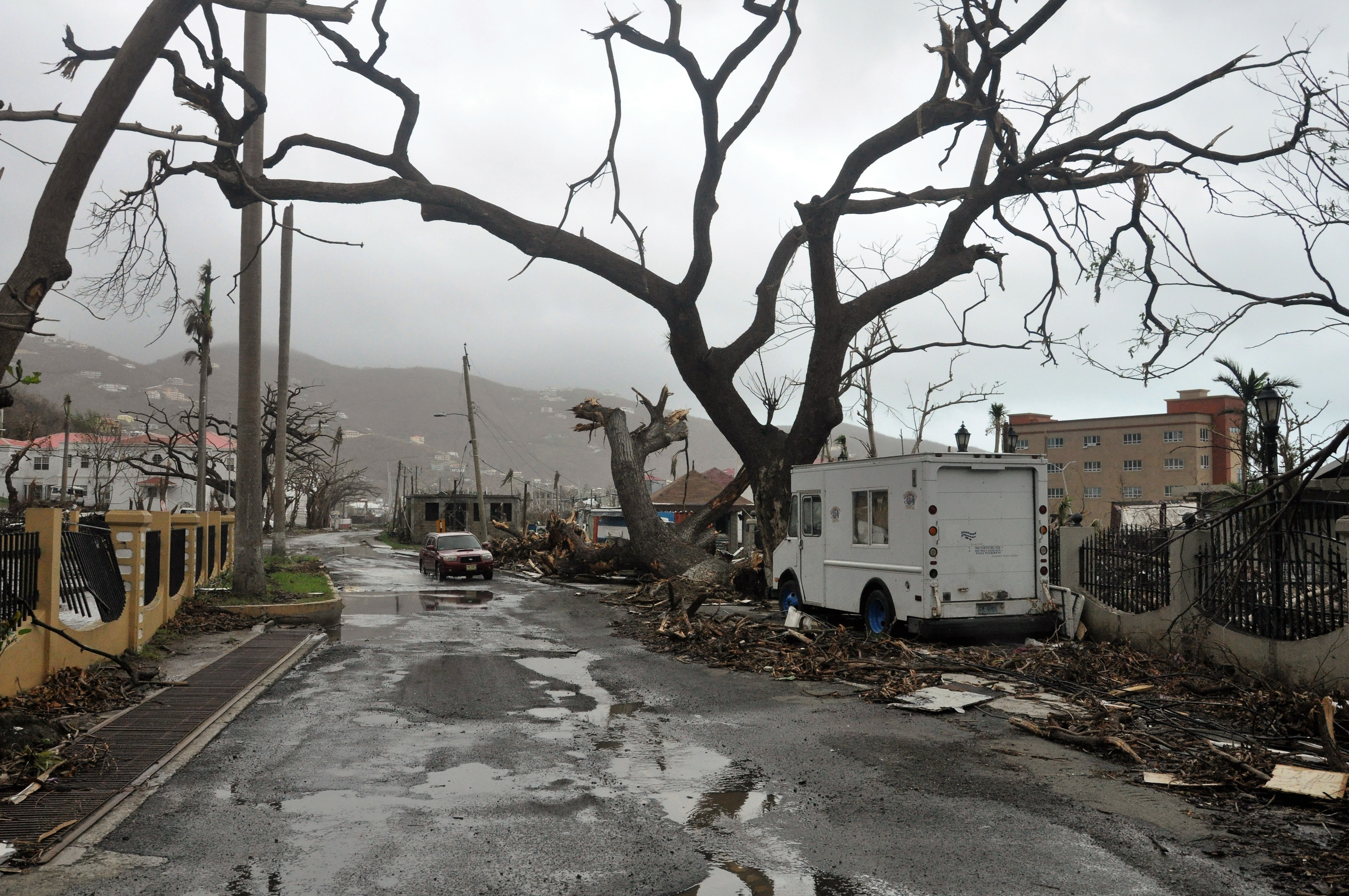 <div class='meta'><div class='origin-logo' data-origin='none'></div><span class='caption-text' data-credit='Freeman Rogers/AP Photo'>Trees stand barren and debris lays on the roadside, caused by Hurricane Maria in Road Town, on the island of Tortola, in the British Virgin Islands, early Wednesday, Sept. 20.</span></div>