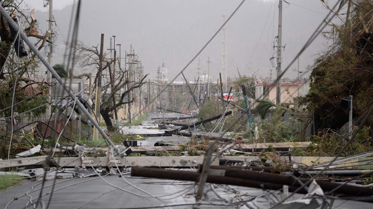 Electricity poles and lines lay toppled on the road after Hurricane Maria hit Humacao, Puerto Rico, Wednesday, Sept. 20, 2017. (Carlos Giusti/AP Photo)