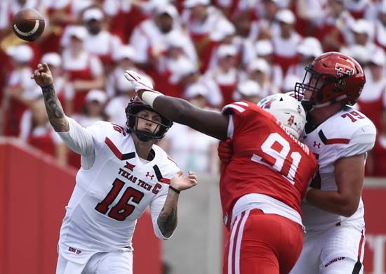 "<div class=""meta image-caption""><div class=""origin-logo origin-image ap""><span>AP</span></div><span class=""caption-text"">Texas Tech quarterback Nic Shimonek (16) throws a pass over Houston defensive end Nick Thurman (91) during the first half. (Eric Christian Smith)</span></div>"