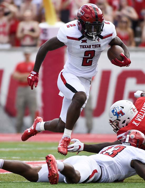 "<div class=""meta image-caption""><div class=""origin-logo origin-image ap""><span>AP</span></div><span class=""caption-text"">Texas Tech wide receiver Keke Coutee (2) leaps over teammate Cameron Batson during the first half of an NCAA college football game against Houston (Eric Christian Smith)</span></div>"