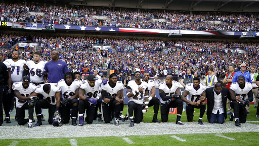 <div class='meta'><div class='origin-logo' data-origin='AP'></div><span class='caption-text' data-credit='AP Photo/Matt Dunham'>Baltimore Ravens players, including former player Ray Lewis, second from right, kneel down during the playing of the U.S. national anthem at Wembley Stadium.</span></div>