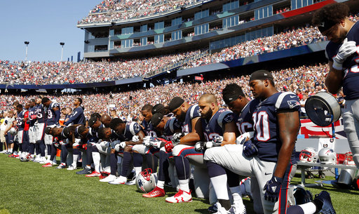 <div class='meta'><div class='origin-logo' data-origin='AP'></div><span class='caption-text' data-credit='AP Photo/Michael Dwyer'>Several New England Patriots players kneel during the national anthem before an NFL football game against the Houston Texans, Sunday, Sept. 24, 2017, in Foxborough, Mass.</span></div>