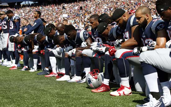 <div class='meta'><div class='origin-logo' data-origin='AP'></div><span class='caption-text' data-credit='Michael Dwyer'>Several New England Patriots players kneel during the national anthem before an NFL football game against the Houston Texans, Sunday, Sept. 24, 2017, in Foxborough, Mass.</span></div>