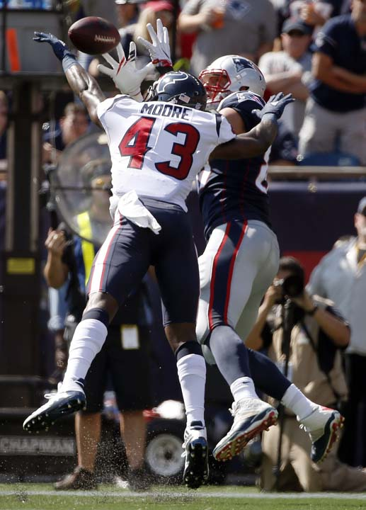 <div class='meta'><div class='origin-logo' data-origin='AP'></div><span class='caption-text' data-credit='Michael Dwyer'>New England Patriots tight end Rob Gronkowski, rear, catches a touchdown pass behind Houston Texans safety Corey Moore (43) during the first half of an NFL football game.</span></div>