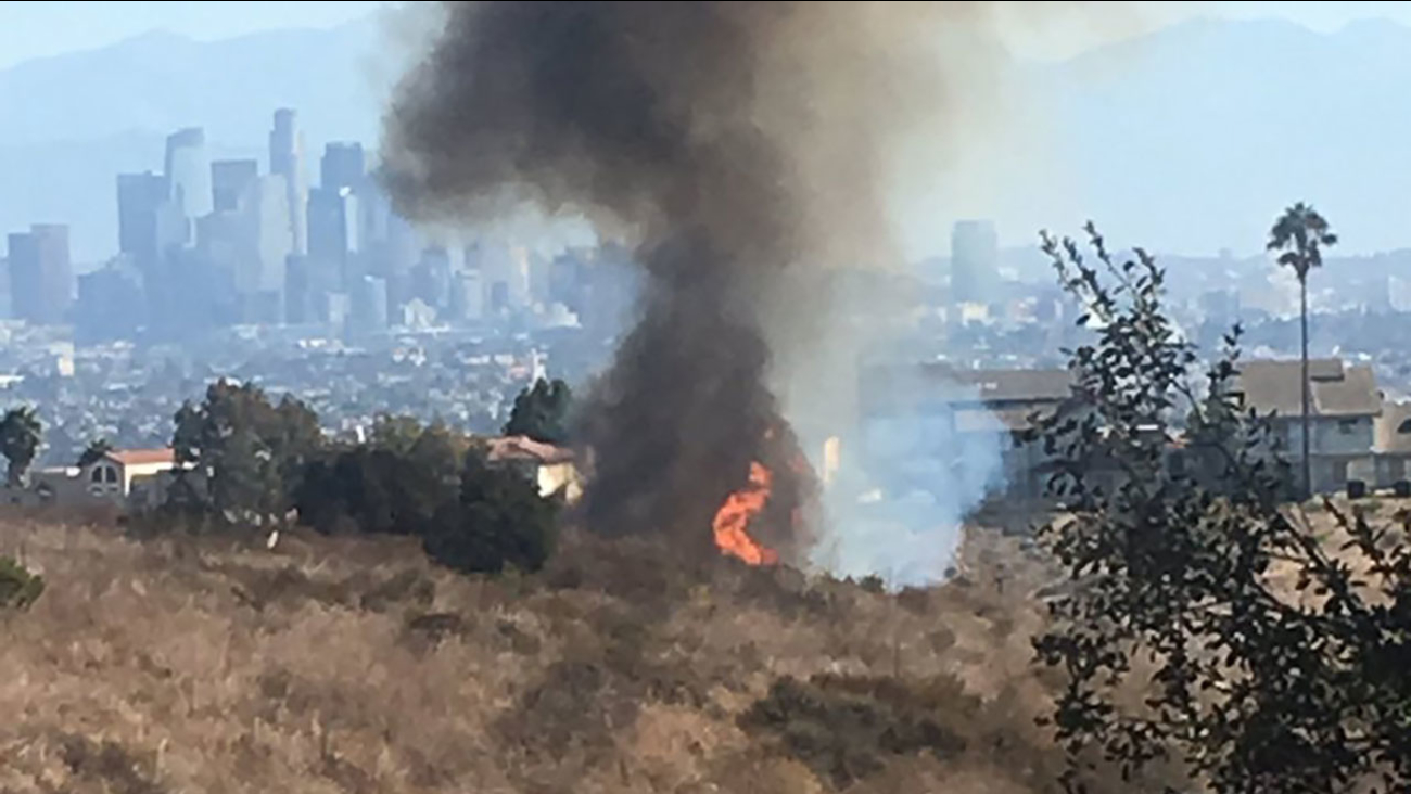 Flames from a brush fire burning at the Kenneth Hahn State Recreation Area near Baldwin Hills on Sunday, Sept. 24, 2017.