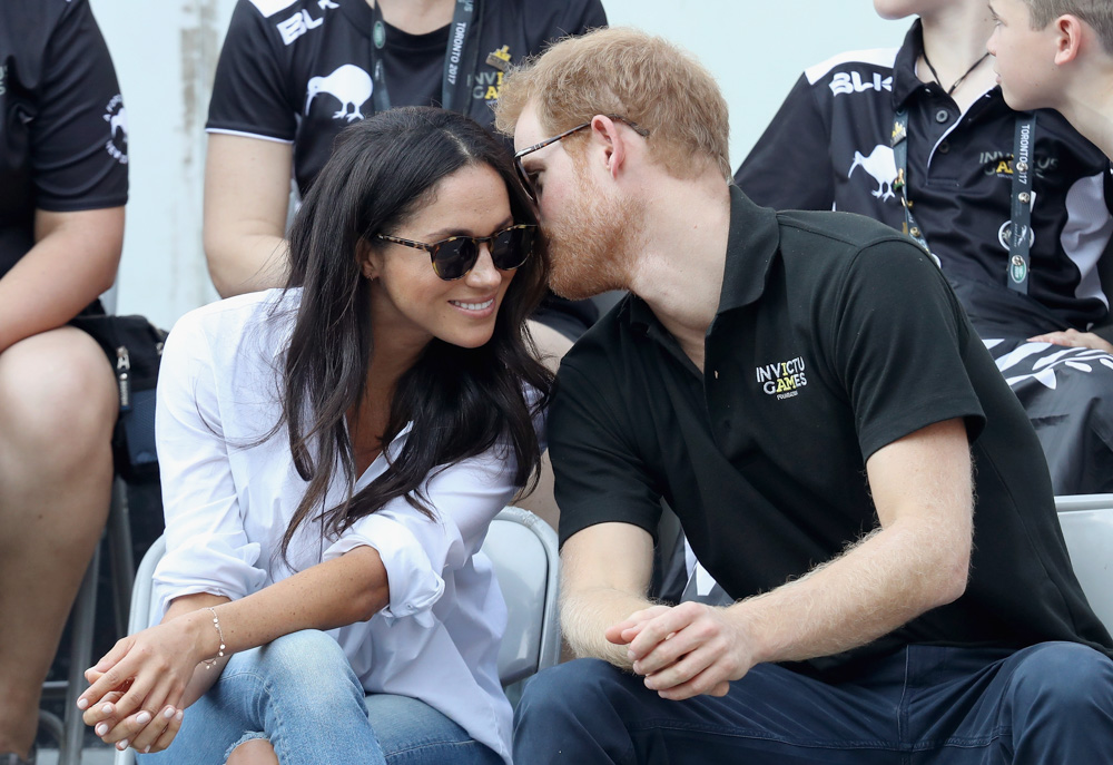 <div class='meta'><div class='origin-logo' data-origin='none'></div><span class='caption-text' data-credit='Chris Jackson/Getty Images for the Invictus Games Foundation'>Prince Harry (R) and Meghan Markle (L) attend a Wheelchair Tennis match during the Invictus Games 2017 at Nathan Philips Square on September 25, 2017 in Toronto, Canada.</span></div>