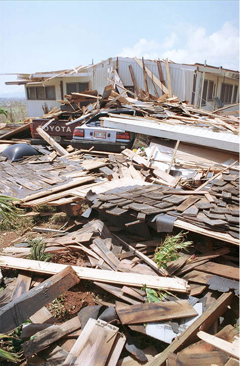"""<div class=""""meta image-caption""""><div class=""""origin-logo origin-image """"><span></span></div><span class=""""caption-text"""">Rubble of a home that was destroyed during Hurricane Iniki. (Reed Saxon / AP)</span></div>"""