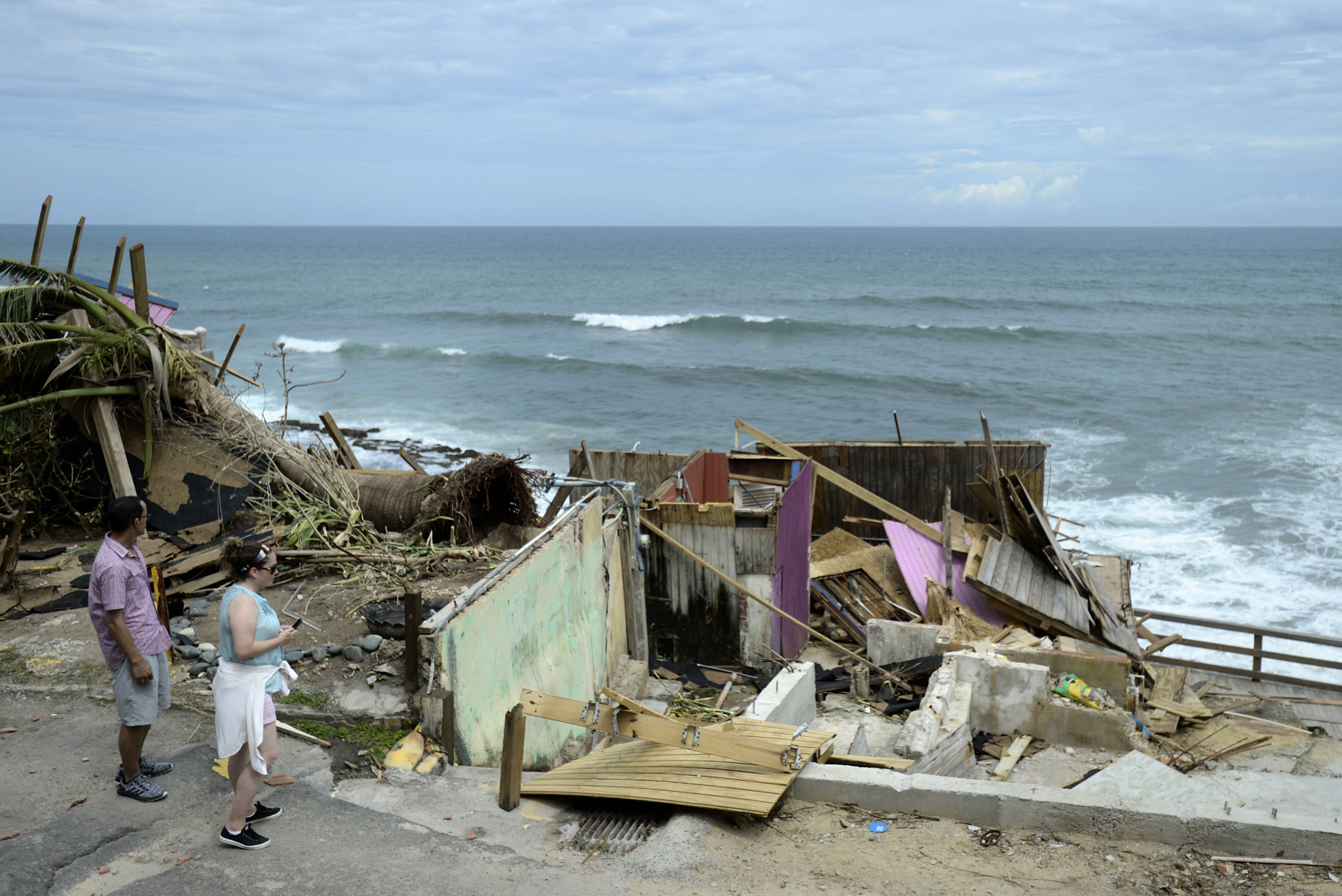 "<div class=""meta image-caption""><div class=""origin-logo origin-image ap""><span>AP</span></div><span class=""caption-text"">Hurricane Maria hit Puerto Rico, leaving behind devastation and more than 1 million without power (AP Photo/Carlos Giusti)</span></div>"