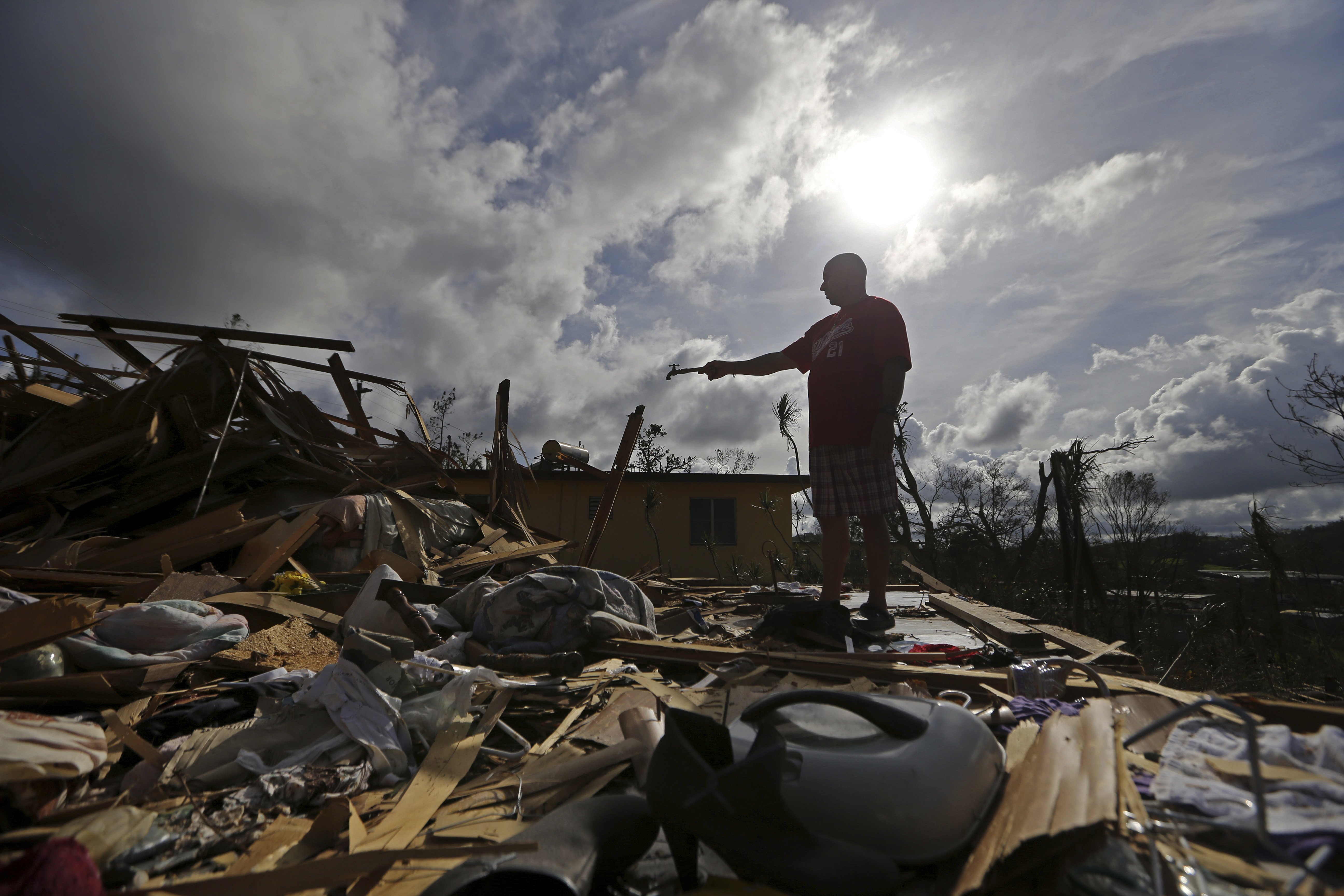 "<div class=""meta image-caption""><div class=""origin-logo origin-image ap""><span>AP</span></div><span class=""caption-text"">Hurricane Maria hit Puerto Rico, leaving behind devastation and more than 1 million without power (AP Photo/Gerald Herbert))</span></div>"