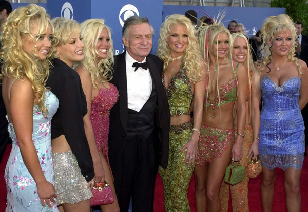 <div class='meta'><div class='origin-logo' data-origin='AP'></div><span class='caption-text' data-credit=''>Hugh Hefner poses with seven Playboy playmates at the 43rd annual Grammy Awards, Feb. 21, 2001, at the Staples Center in Los Angeles.</span></div>