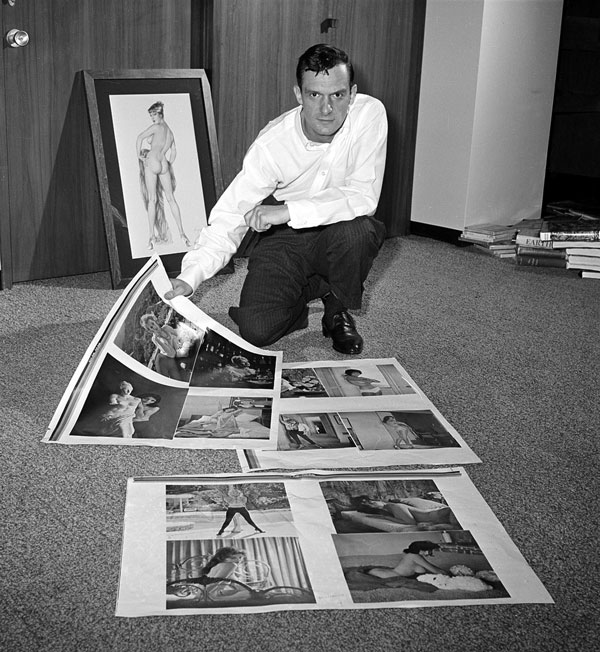 <div class='meta'><div class='origin-logo' data-origin='AP'></div><span class='caption-text' data-credit=''>Publisher Hugh Hefner looks over proof sheets for his magazine Playboy, in Chicago, on June 20, 1961.</span></div>