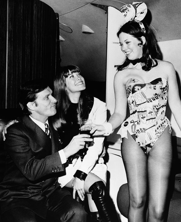 "<div class=""meta image-caption""><div class=""origin-logo origin-image ap""><span>AP</span></div><span class=""caption-text"">In March 1970, Hugh Hefner and girlfriend Barbi Benton, center, are served by a Playboy Club bunny upon their arrival aboard the Big Bunny, Heffner's jet, in New York.</span></div>"