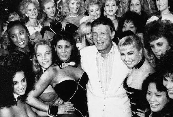 <div class='meta'><div class='origin-logo' data-origin='AP'></div><span class='caption-text' data-credit=''>Hugh Hefner poses with current and former Playboy bunnies at the Playboy Club, June 25, 1986, in Los Angeles.</span></div>