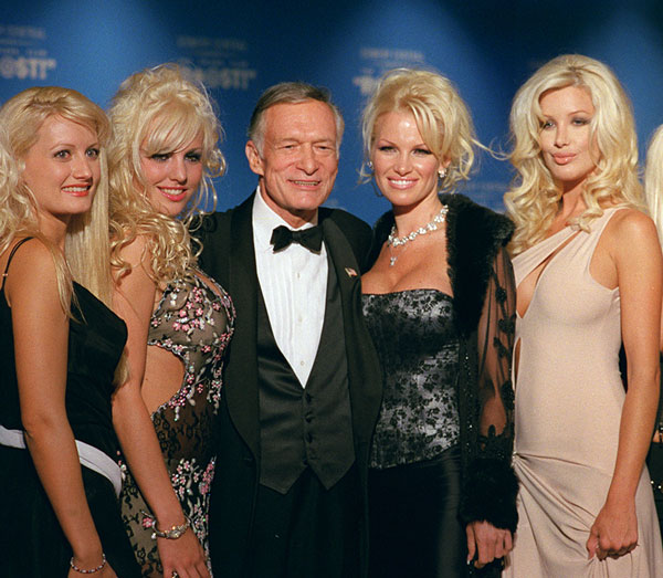 <div class='meta'><div class='origin-logo' data-origin='AP'></div><span class='caption-text' data-credit=''>Hugh Hefner appears with Pamela Anderson and some of his girlfriends before the New York Friars Club Roast on Sept. 29, 2001.</span></div>