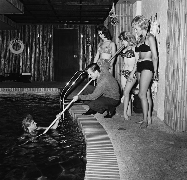 "<div class=""meta image-caption""><div class=""origin-logo origin-image ap""><span>AP</span></div><span class=""caption-text"">Playing at having fun, Hugh Hefner rescues one of the swimmers in the indoor pool of his $400,000 apartment, June 20, 1961, Chicago.</span></div>"