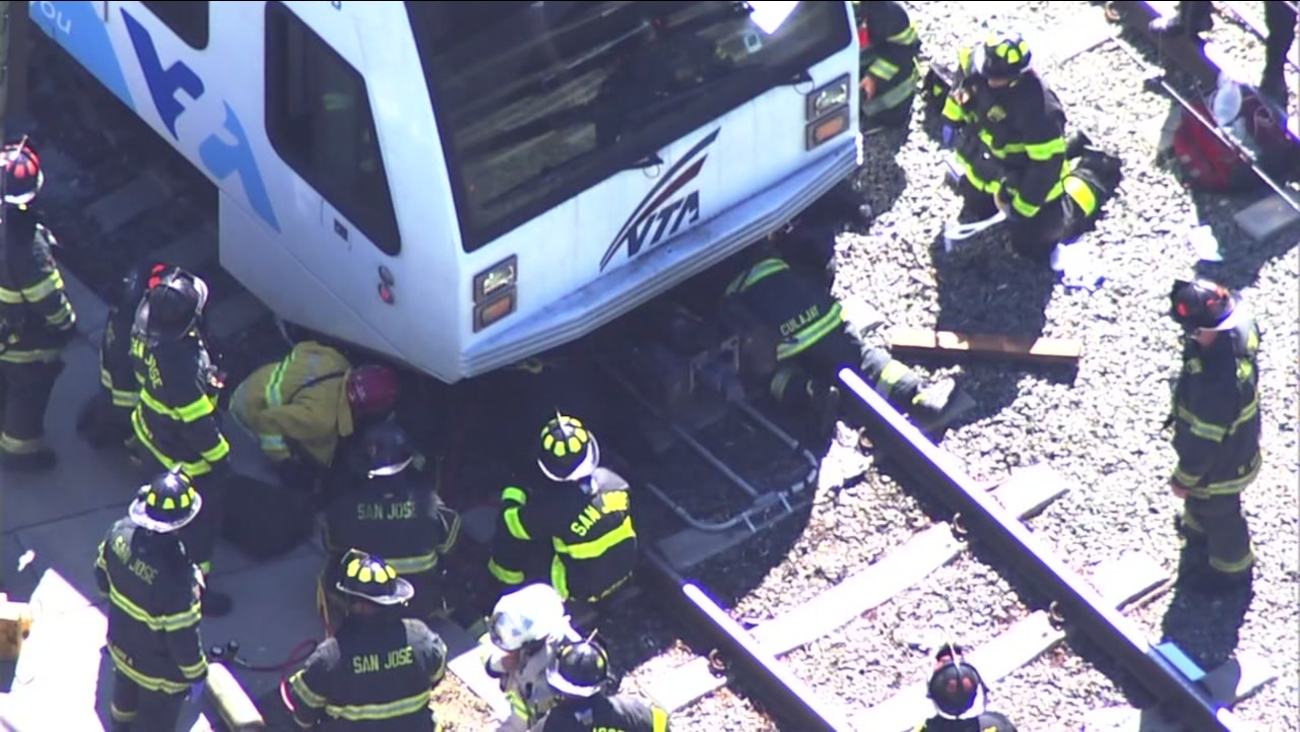 Crews are seen trying to help a person who got trapped under a VTA train in San Jose, Calif. on Thursday, September 28, 2017.