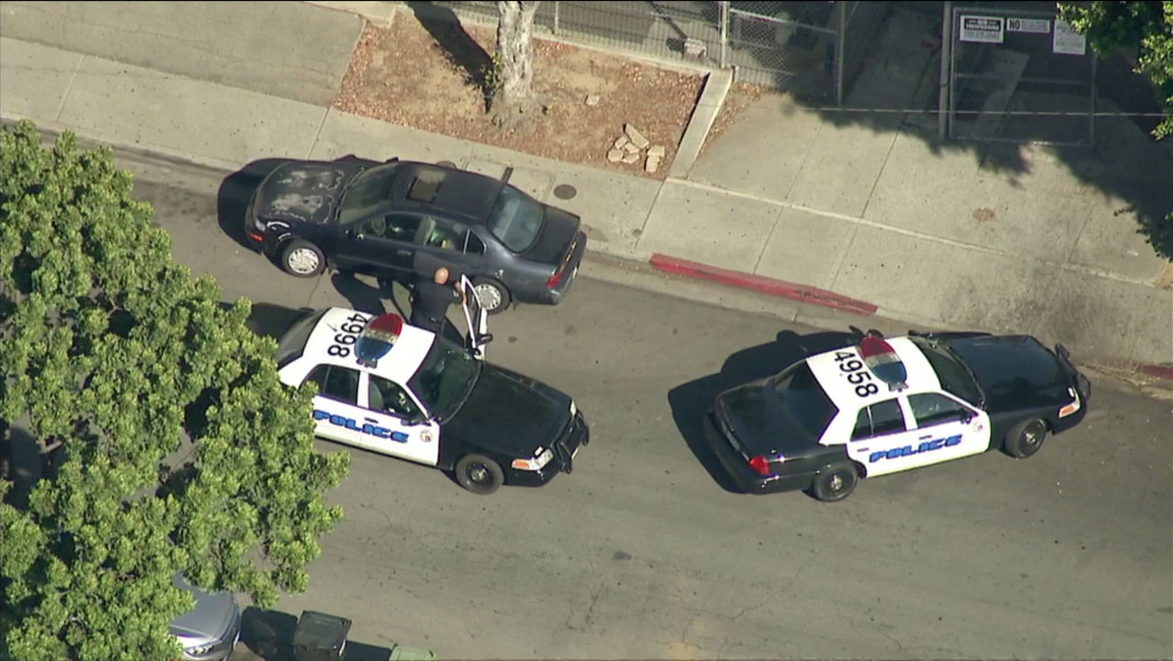 Garfield High School in East Los Angeles is on lockdown as authorities search for three suspects who attacked a man with a baseball bat.