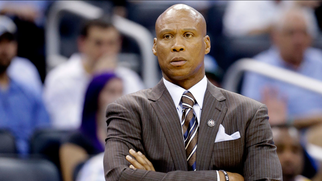 Los Angeles Lakers head coach Byron Scott watches his team on the court against the Orlando Magic during an NBA basketball game, Wednesday, Nov. 11, 2015.