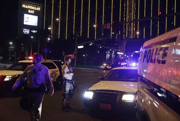 "<div class=""meta image-caption""><div class=""origin-logo origin-image ap""><span>AP</span></div><span class=""caption-text"">Police officers stand along the Las Vegas Strip outside the Mandalay Bay resort and casino (AP Photo/John Locher) (AP)</span></div>"