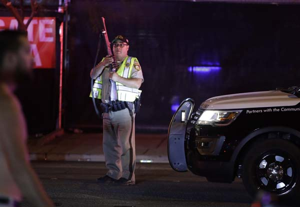 "<div class=""meta image-caption""><div class=""origin-logo origin-image ap""><span>AP</span></div><span class=""caption-text"">A police officer stands at the scene of a shooting along the Las Vegas Strip, Monday, Oct. 2, 2017, in Las Vegas. (AP Photo/John Locher) (AP)</span></div>"