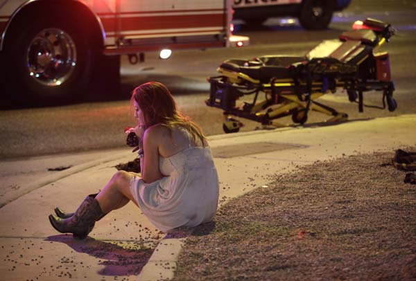 <div class='meta'><div class='origin-logo' data-origin='AP'></div><span class='caption-text' data-credit='AP'>A woman sits on a curb at the scene of a shooting outside of a music festival along the Las Vegas Strip, Monday, Oct. 2, 2017, in Las Vegas. (AP Photo/John Locher)</span></div>