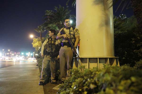 "<div class=""meta image-caption""><div class=""origin-logo origin-image ap""><span>AP</span></div><span class=""caption-text"">Police officers take cover near the scene of a shooting near the Mandalay Bay resort and casino on the Las Vegas Strip, Sunday, Oct. 1, 2017, in Las Vegas. (AP Photo/John Locher) (AP)</span></div>"