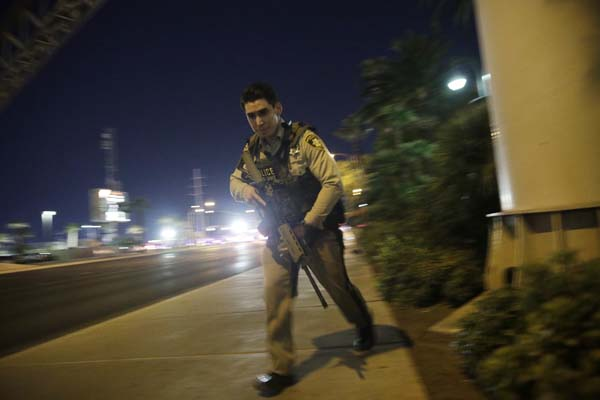 <div class='meta'><div class='origin-logo' data-origin='AP'></div><span class='caption-text' data-credit='AP'>A police officer runs along a sidewalk near a shooting near the Mandalay Bay resort and casino on the Las Vegas Strip, Sunday, Oct. 1, 2017, in Las Vegas. (AP Photo/John Locher)</span></div>