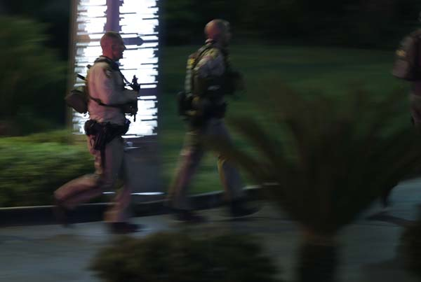 <div class='meta'><div class='origin-logo' data-origin='AP'></div><span class='caption-text' data-credit='AP'>Police officers rush into the Mandalay Bay resort and casino during a shooting near the casino on the Las Vegas Strip, Sunday, Oct. 1, 2017, in Las Vegas. (AP Photo/John Locher)</span></div>