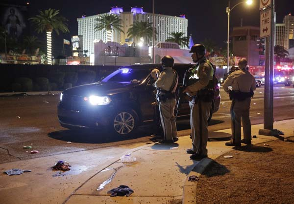 "<div class=""meta image-caption""><div class=""origin-logo origin-image ap""><span>AP</span></div><span class=""caption-text"">Las Vegas Police stand at the scene of a shooting along the Las Vegas Strip, Monday, Oct. 2, 2017, in Las Vegas. (AP Photo/John Locher) (AP)</span></div>"