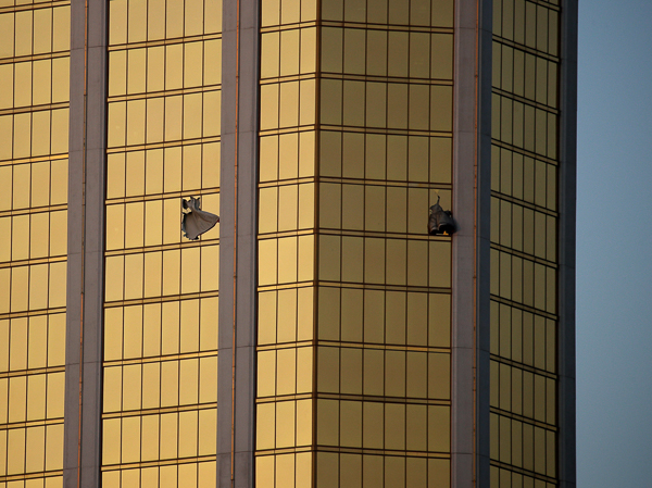 <div class='meta'><div class='origin-logo' data-origin='AP'></div><span class='caption-text' data-credit='AP'>Drapes billow out of broken windows at the Mandalay Bay resort and casino Monday, Oct. 2, 2017, on the Las Vegas Strip following a deadly shooting at a music festival in Las Vegas.</span></div>