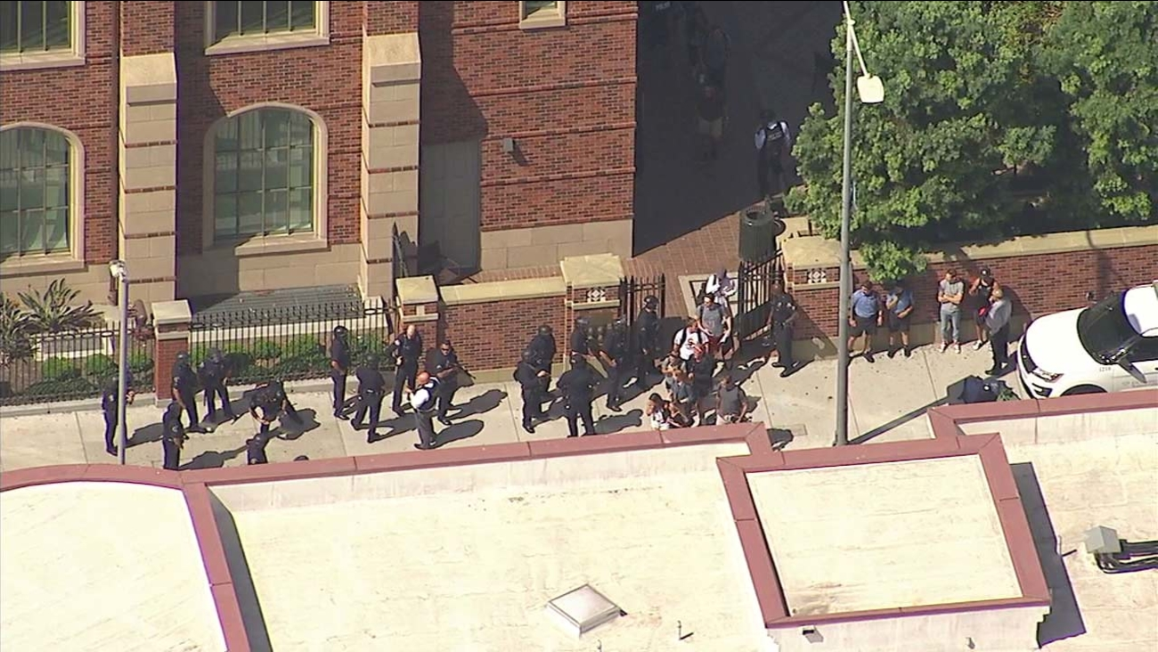 Los Angeles police officers and students are seen at the USC campus following reports of possible shots fired on Monday, Oct. 2, 2017.