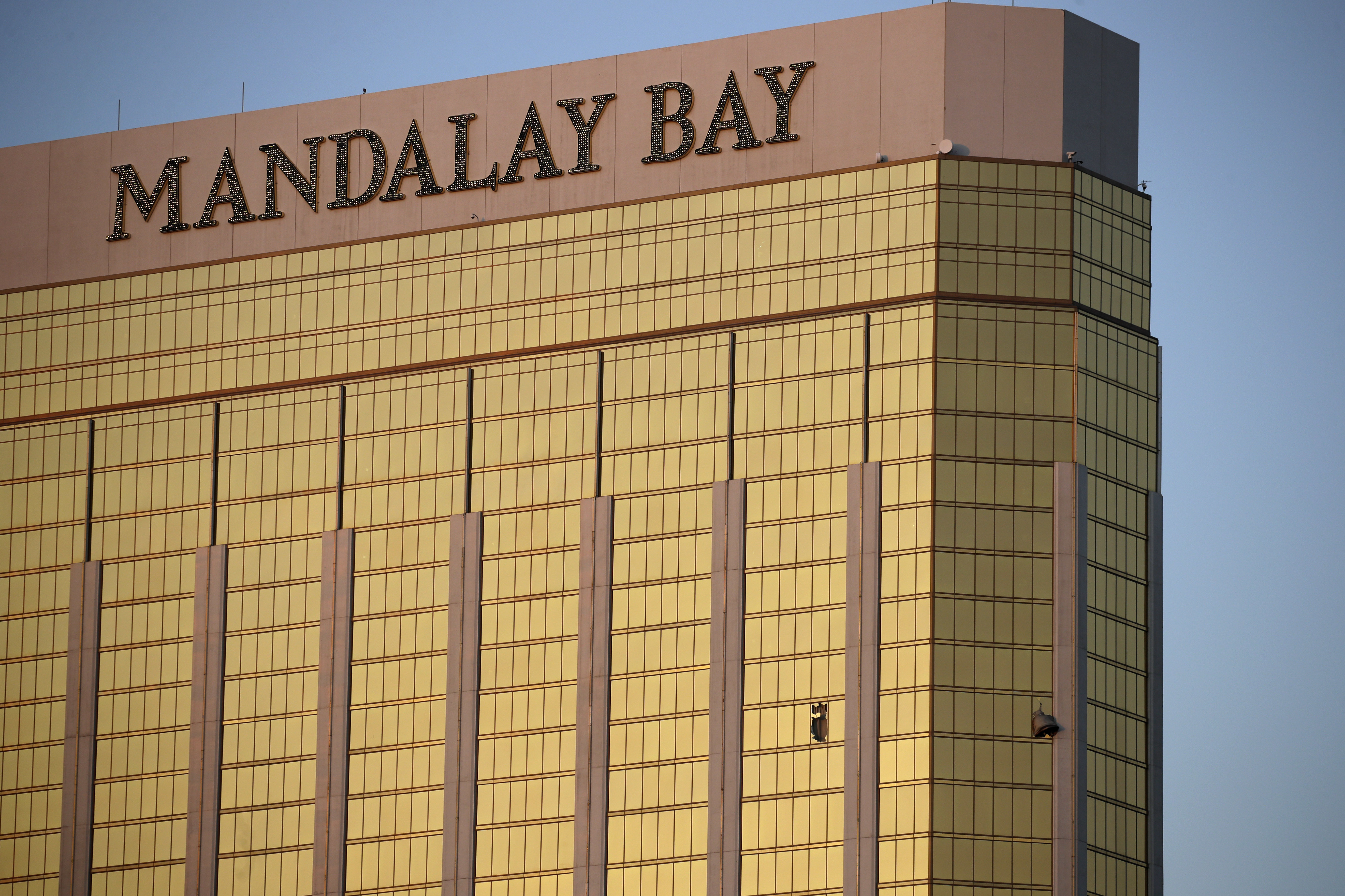 <div class='meta'><div class='origin-logo' data-origin='none'></div><span class='caption-text' data-credit='John Locher/AP Photo'>Drapes billow out of broken windows at the Mandalay Bay resort and casino Monday, Oct. 2, 2017.</span></div>