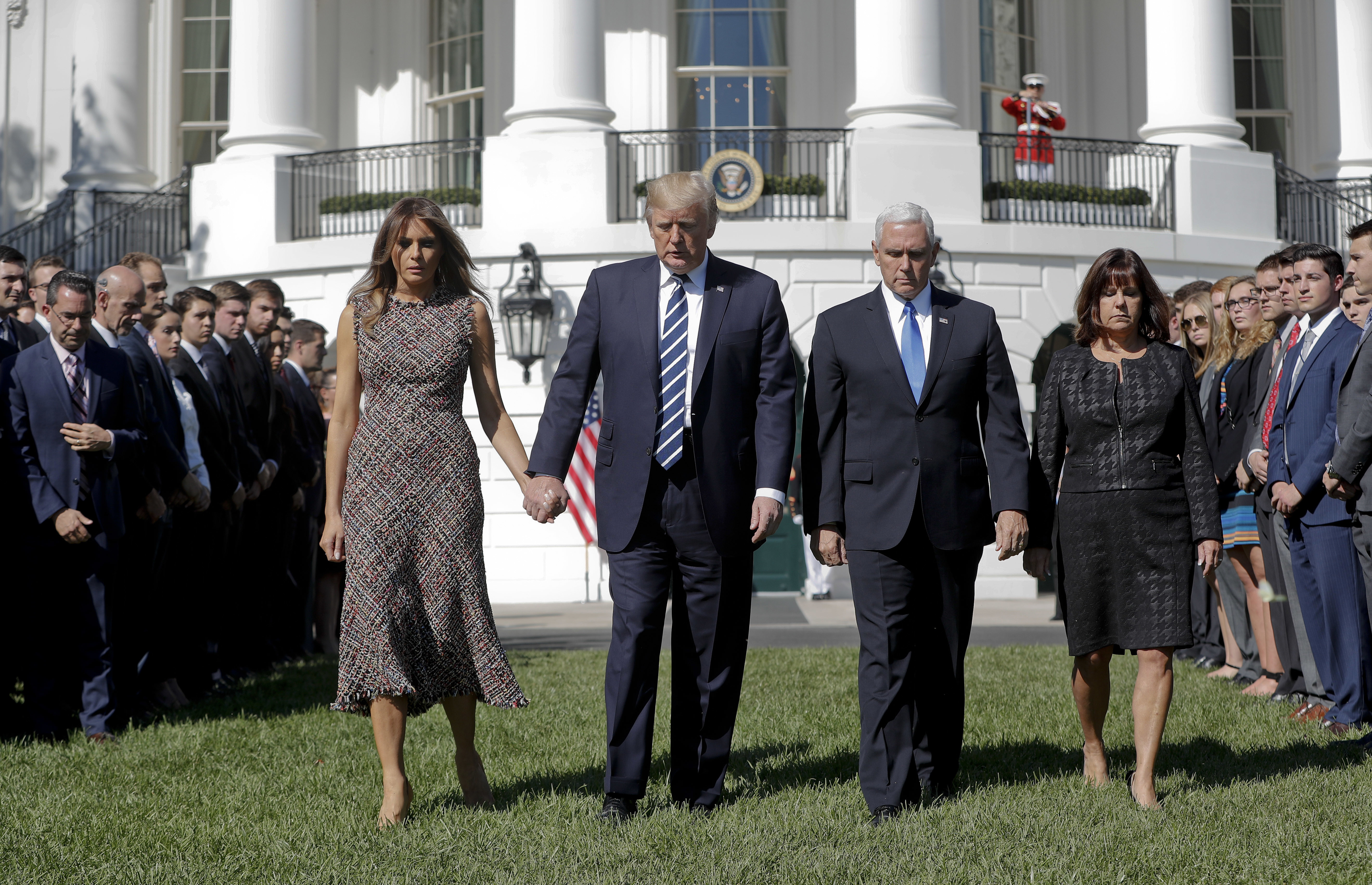 <div class='meta'><div class='origin-logo' data-origin='none'></div><span class='caption-text' data-credit='Pablo Martinez Monsivais/AP Photo'>President Donald Trump and first lady Melania Trump walk with with Vice President Mike Pence and his wife Karen on the South Lawn of the White House on Monday.</span></div>