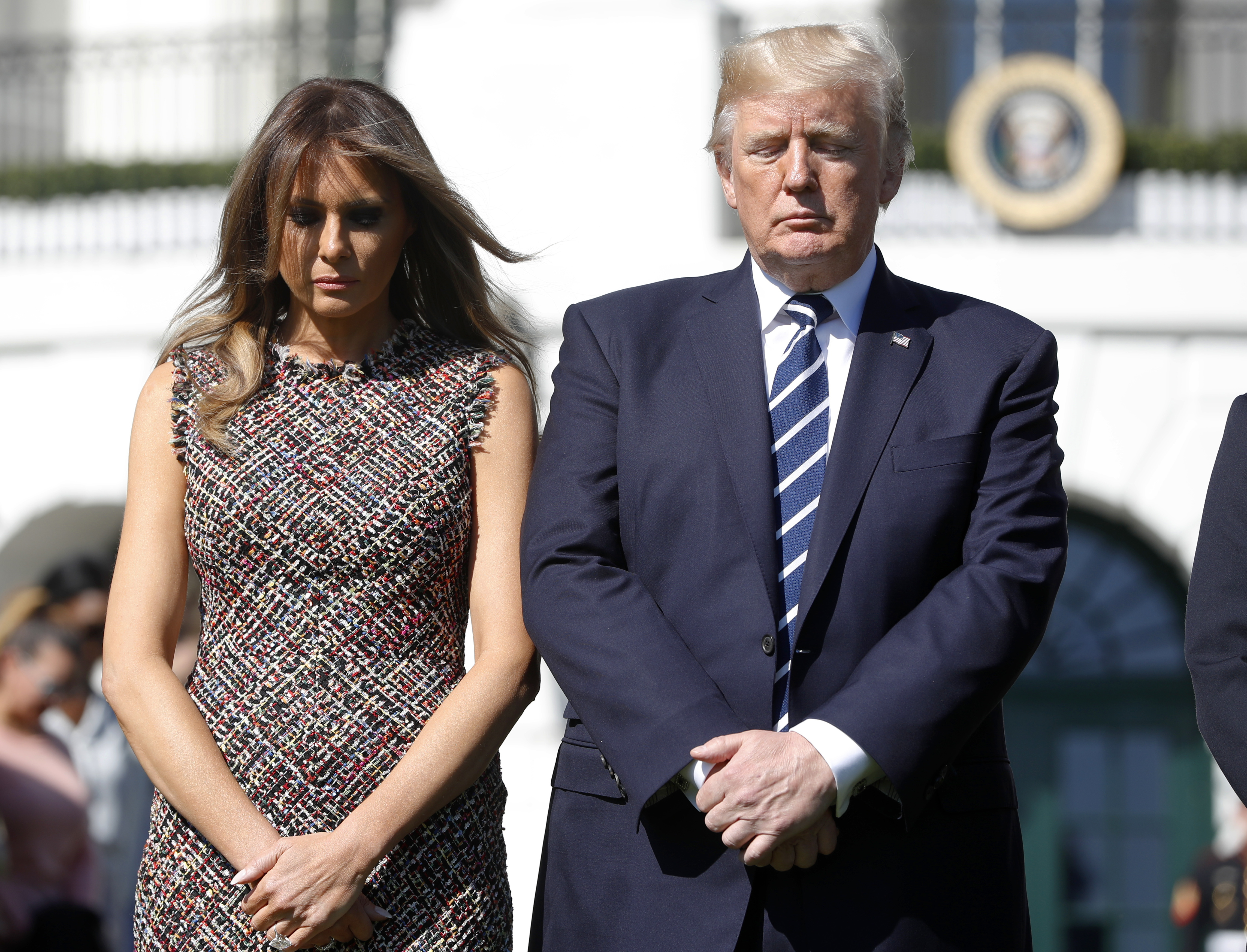<div class='meta'><div class='origin-logo' data-origin='none'></div><span class='caption-text' data-credit='APPablo Martinez Monsivais/AP Photo'>President Donald Trump and first lady Melania Trump stand during a moment of silence to remember the victims of the mass shooting.</span></div>