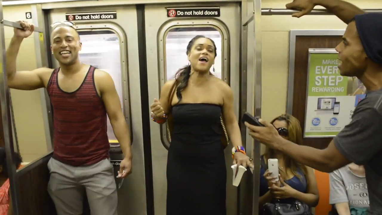 The Broadway Cast of The Lion King performing 'The Circle of Life' for subway riders in New York