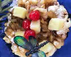 "<div class=""meta image-caption""><div class=""origin-logo origin-image none""><span>none</span></div><span class=""caption-text"">Blue Hawaiian Funnel Cake with pineapple topping, praline, whipped cream & cherries. Served by Gobblin' Gourmet near the Field of Dreams (Credit: NC State Fair)</span></div>"