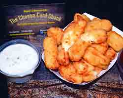 "<div class=""meta image-caption""><div class=""origin-logo origin-image none""><span>none</span></div><span class=""caption-text"">Deep Fried Crab Cake Cheese Curds - Wisconsin premium white cheddar cheese curds lightly breaded with cooked snow crab and shrimp. Served by Cheese Curd Shack near Midway (Credit: NC State Fair)</span></div>"